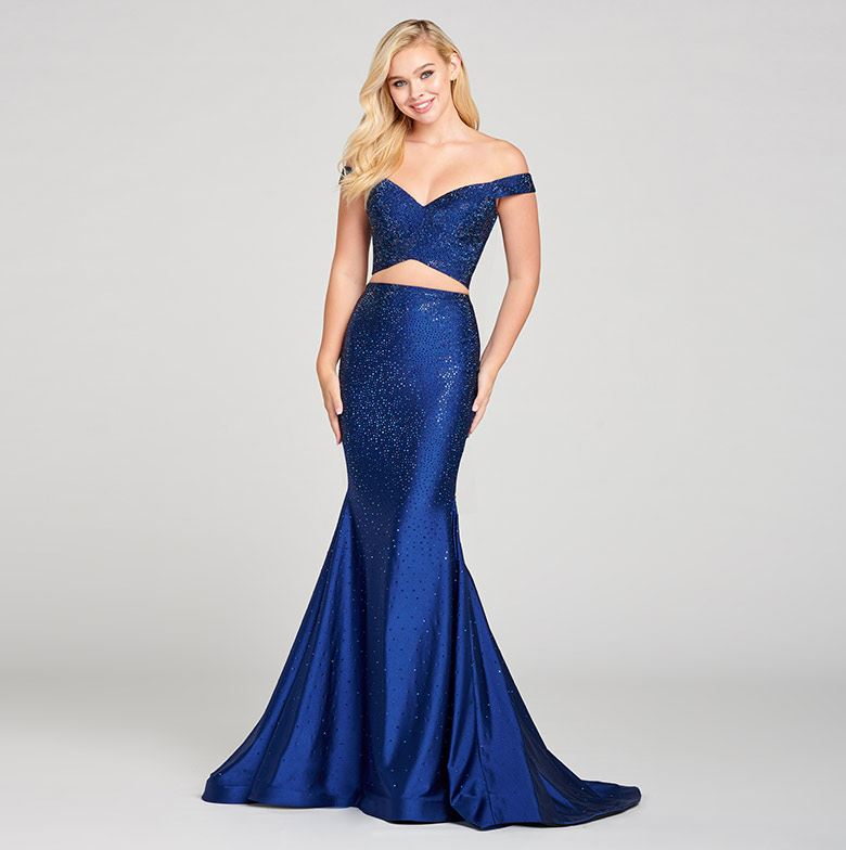 Blonde model in sparkly blue two piece prom dress by Ellie Wilde