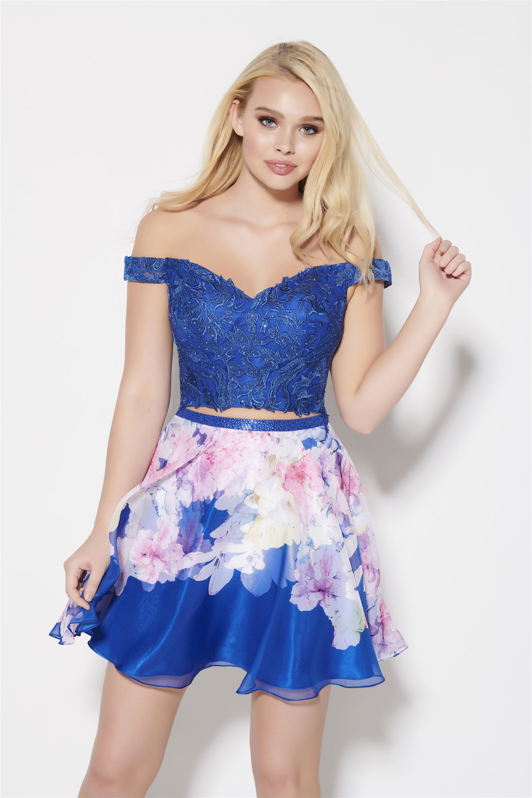 Blonde girl in blue two piece homecoming dress