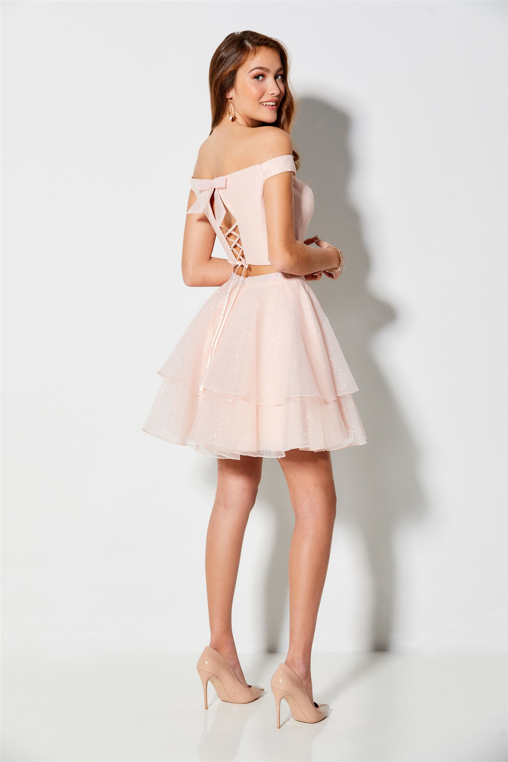 Brunette girl in pink two piece homecoming dress