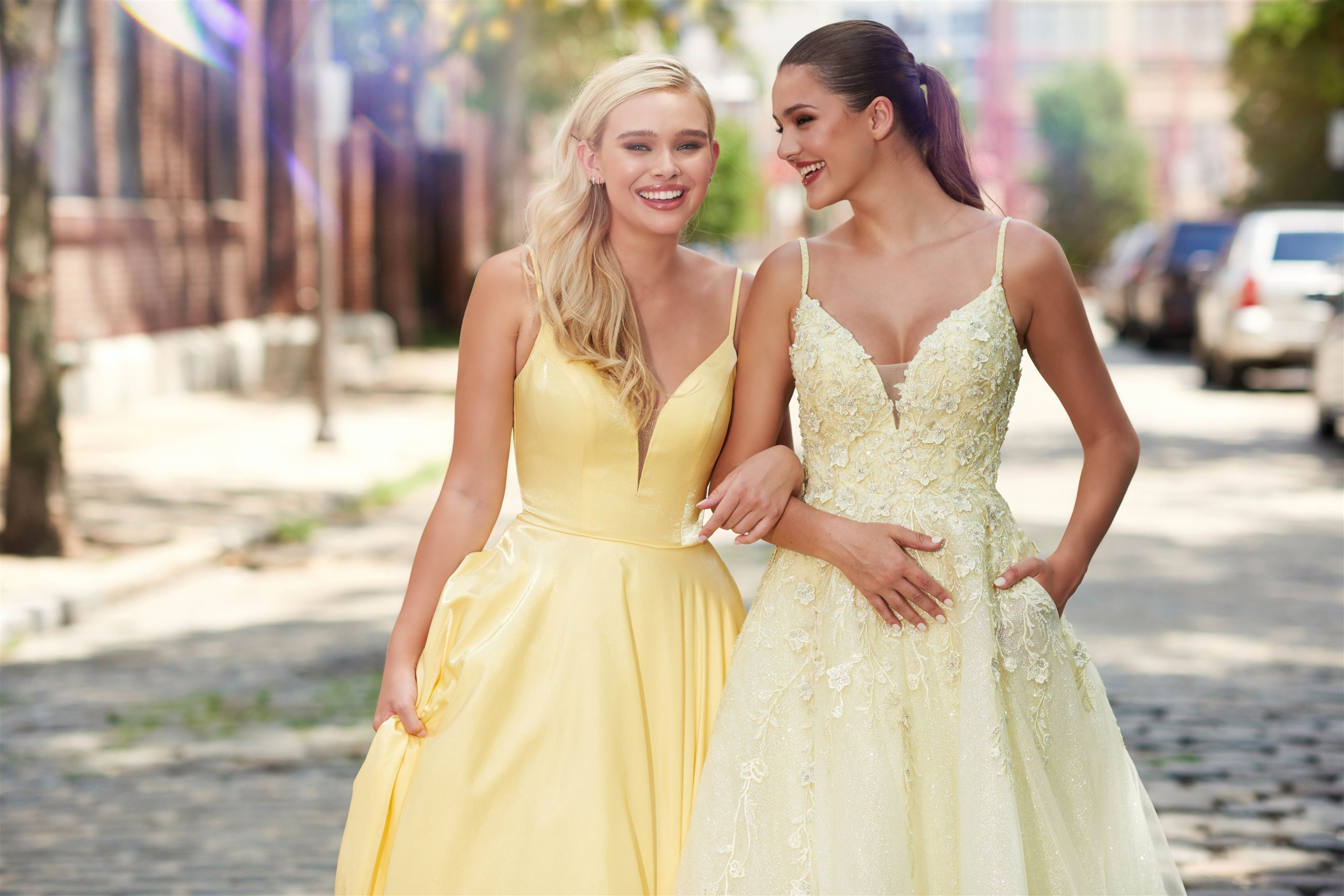 Two girls in yellow prom dresses with pockets by Ellie Wilde