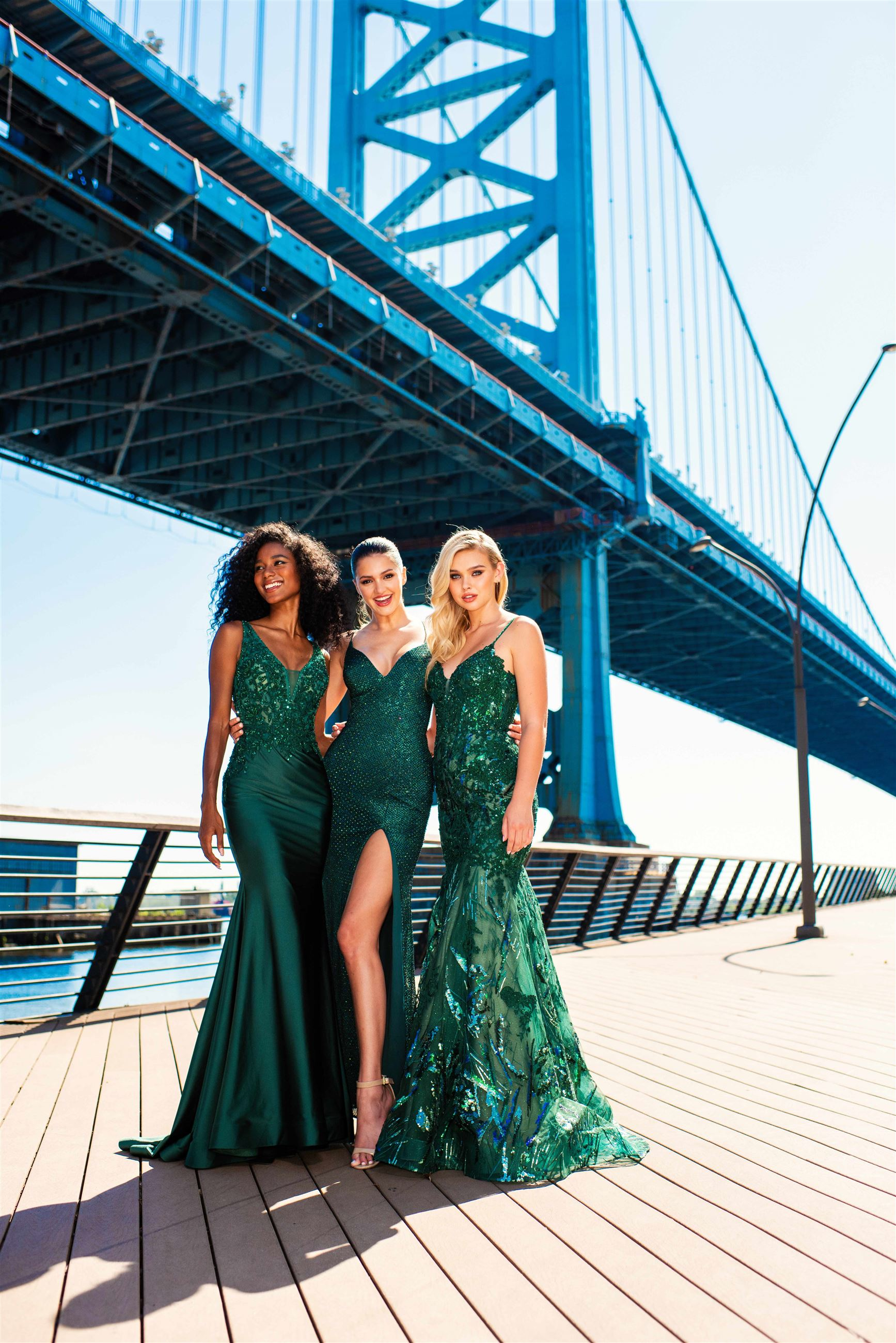 Three girls wearing green prom dresses by Ellie Wilde