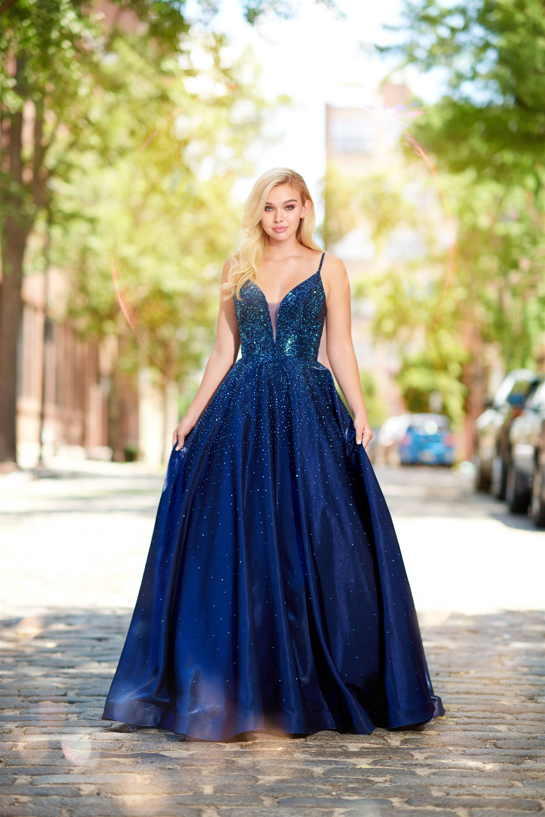 Girl wearing navy blue prom dress with sequin details by Ellie Wilde