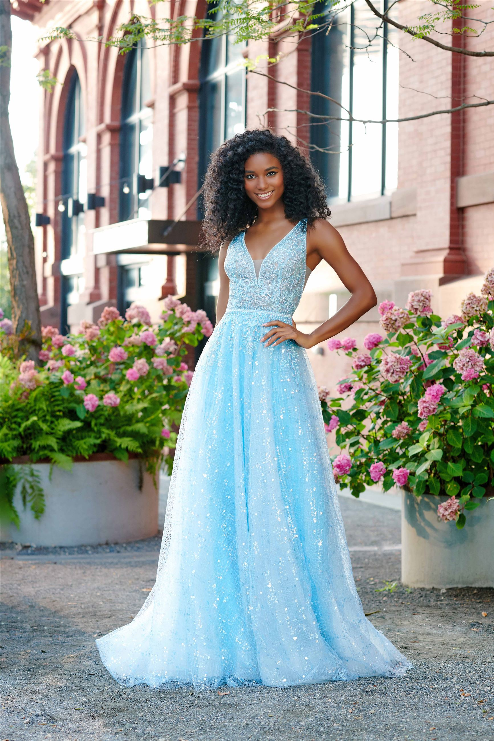 Girl wearing sparkly blue prom dress by Ellie Wilde